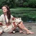 Woman in traditional Russian (slavic) costume — Stock Photo #49653171