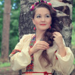 Woman in traditional Russian (slavic) costume — Stockfoto