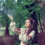 Woman in traditional Russian (slavic) costume — Stock Photo #49653249