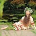 Woman in traditional Russian (slavic) costume — ストック写真