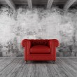 Grunge interior with red armchair — Stock Photo #13165729