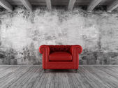 Grunge interior with red armchair — Stock Photo