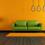 Modern green and orange livingroom — Stock Photo