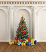 Classic interior with christmas-tree and ionic column — Stock Photo