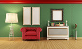 Vintage room with red classic armchair — Stock Photo