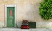 Old house with vintage suitcases — Stock Photo