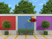 Street with bench and colorful balloons — Photo