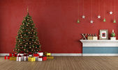 Old red room with christmas tree — ストック写真