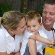 Parents and child on a playground - Stock Photo