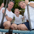 Parents with child at the playground - Stock Photo