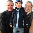 Stock Photo: Family picture - parents with 2 year old son -