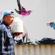 Постер, плакат: Chinese Man coming from the Bird Market
