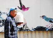 Chinese Man coming from the Bird Market — Stock Photo