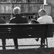 Three persons sitting on the bench — Stock Photo