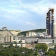 Panorama of a cement plant in a sunny summer afternoon — Stock Photo