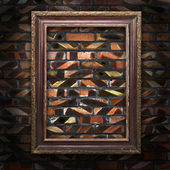 Old picture frames on the brick wall — Stock Photo