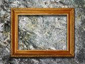Bilderrahmen auf stein grunge hintergrund — Stockfoto