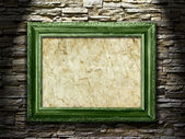Picture frame on a stone grunge background, highlight — Stock fotografie
