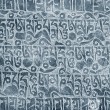 Buddhist mantra carved in stone — Stock Photo