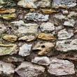 Old wall of rough stones - Stock Photo