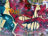 Pedaço de imagens de graffiti em uma parede de tijolo antigo — Fotografia Stock