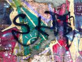 Pedazo de imágenes de graffiti en una pared de ladrillo antiguo — Foto de Stock