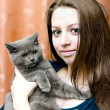 Stock Photo: Beautiful girl with cat on hands