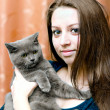 Royalty-Free Stock Photo: Beautiful girl with a cat on hands