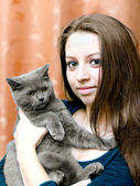 Beautiful girl with a cat on hands — Stock Photo