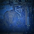 back side of the motherboard closeup, light effect, blue tone — Zdjęcie stockowe