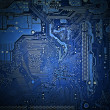 back side of the motherboard closeup, light effect, blue tone — Foto Stock
