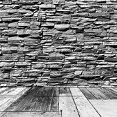 Room with stone walls and wooden floors — Stock Photo