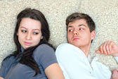 Young guy and girl look at each other — Stock Photo