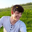 Portrait of a laughing young man outdoors — Stock Photo #25908305
