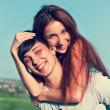 Young guy and girl having fun in the summer outdoors — Stock Photo