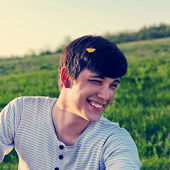 Portrait of a laughing young man outdoors — Stock Photo