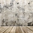 Concrete wall and wooden floor in a grunge style — Stock Photo #27934005