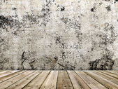 Concrete wall and wooden floor in a grunge style — Stock Photo