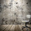 Office old plastic chair in a grunge interior — Stock Photo