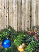 Christmas pine twigs with colored balls — Stock Photo
