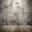 Concrete wall and wooden floor in a grunge style — Stock Photo #29927741