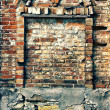Stock Photo: Crumbling brick wall with arch