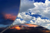 Zip lock separating the sky at night and day — Stock Photo