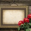 Old vintage frame for photos and a bouquet of red roses — Stock Photo #32454679