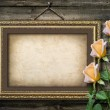 Old vintage frame for photos and a bouquet of yellow roses — Stock Photo #33271985