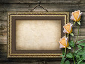 Old vintage frame for photos and a bouquet of yellow roses — Stock Photo