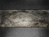 Old scratched metal plate on the background grid — Stock Photo