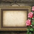 Old vintage frame for photos and a bouquet of yellow roses — Stock Photo #34980291
