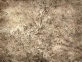 старый треснувший лист пергамента в стиле гранж фон — Стоковое фото