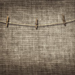 Clothesline with clothespins on linen background — Stockfoto